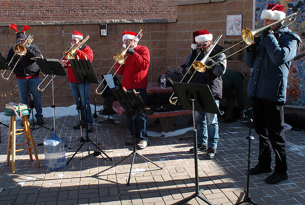 Members of the Santa's Trombones play for visitors to downtown Loveland during the Winter Walk event on Dec. 5. From left are Todd Brubaker, Charlie Spillman, Mike Conway, Brian Sharpe and Wilson Winner.