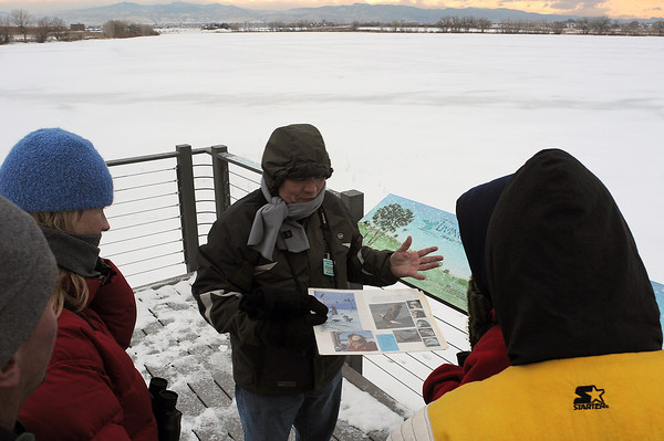 Larimer County Parks and Open Land Volunteer Carl Sorrentino, center, talks with Dave Metcalf, Olivia Hutton, Gary Warner, and Trish Warner during an eagle walk at Fossil Creek Open Space on Dec. 18.