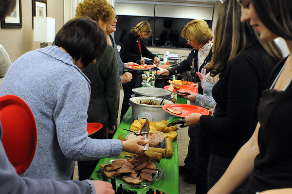 Nurses and staff of the Ob/Gyn department have a potluck before a staff meeting on Wednesday at McKee Medical Center.
