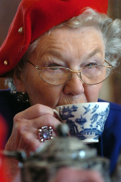 Member of the Happy Hatters Berta Wagar sips tea during a lunch at the McCreery House during the group's monthly meeting.