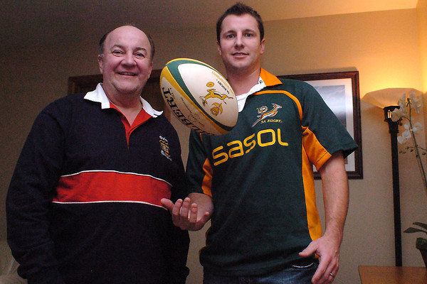 "Barry Thompson, left, and his son, Ryan, went to the Rugby World Cup in June 1995 in South Africa that is included as part of the movie ""Invectus,"" which also chronicles the life of Nelson Mandela. Ryan was 13 years old and kept a scrapbook of the events surrounding the World Cup."