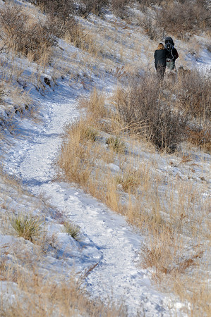 Hikers walk along the Wild Loop trail on Sunday at Devil's Backbone Open Space.