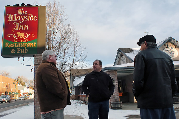 Bob Ford, left, a Realtor with Prudential Real Estate of the Rockies, shows The Wayside Inn property to Jim Parilla and Chuck Liss on Friday in downtown Berthoud.