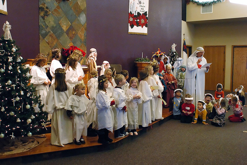 Youngsters take part in a play during the Christmas for Kids event on Saturday at Abiding Love Lutheran Church, 2825 E. First St.