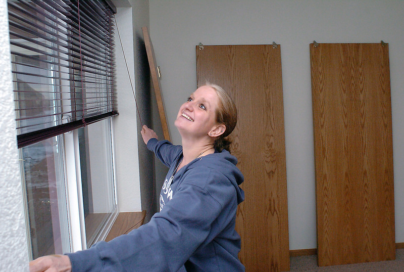 Deserie tries out the blinds in her 14-year-old son Eli's room Wednesday in their new home that's being built by Loveland Habitat for Humanity Women Build. Deserie, her family, Habitat staff and the Women Build volunteers will all celebrat with a dedication at 10 a.m. Saturday.