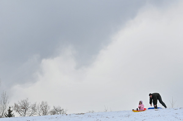 Michael Robeson, of Loveland, pushes his daughter Sarah, 5, down the sledding hill at Kroh park on Dec. 13.