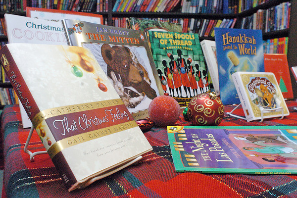 Books on display at Anthology Bookstore in downtown Loveland sit among holiday decorations.