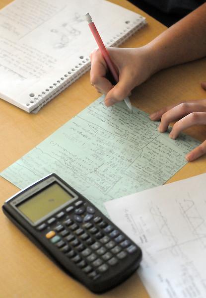 Mountain View High School senior Celena Ealey, 17, writes notes on a study sheet for testtaking during trigonometry class Thursday.