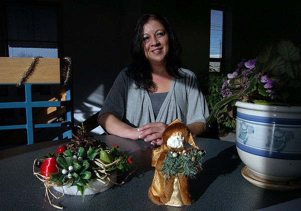 Teresa Rodriguez poses for a portrait while talking about the help she receives from the House of Neighborly Service in Loveland.