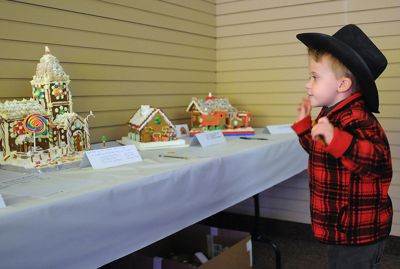 Five-year-old Chance Hill looks at gingerbread houses on display Saturday in downtown Loveland as part of the Friends of the Loveland Public Library's second annual Gingerbread House Challenge. The entries were judged and also included in a silent auction with proceeds benefiting the renovation and expansion project of the library.