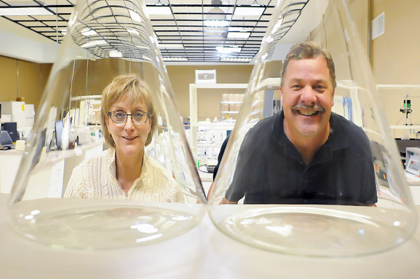 Nanopartz Inc. co-founders Shelley Coldiron, left, and Christian Schoen pose together Wednesday in the research laboratory of their Loveland-based business.