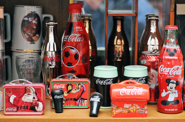 Victoria Villavicencia has collected a wide variety of Coca-Cola memorabilia for more than 20 years including cans and bottles from other countries and miniature lunch pails.
