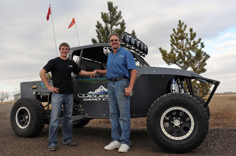 Troy Dees, left, and Tom Franks pose Dec. 17, 2010 in front of an off-road sand truck at Franks' business, Colorado Sandcars, in Windsor.