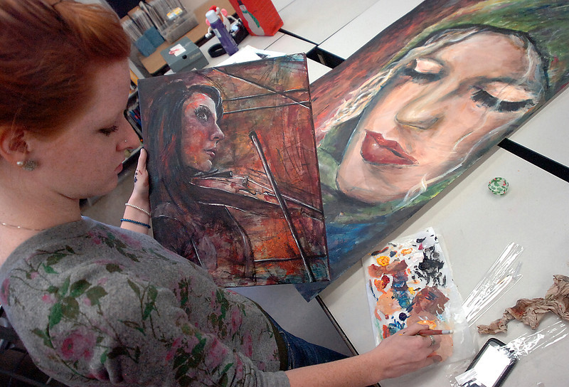 Thompson Valley High School art student Molly Markow works on an acrylic painting Thursday duirng class. Markow is one of 13 students statewide to win the gold key portfolio award.