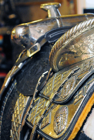 The silver saddles Dusty Johnson restores have intricate designs in both the silver and leather that make up the saddle.