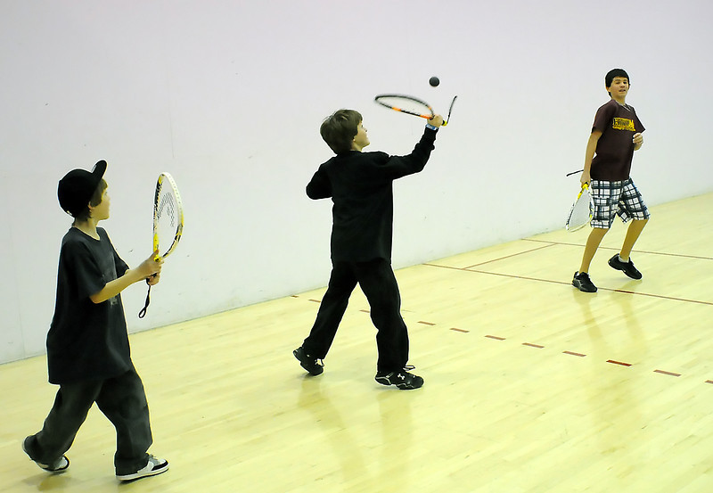 Sawyer Walker, 10, left, Keaton Walker, 12, and Alex Hannaford, 13, play raquetball together at the Chilson Recreation Center on Dec. 18, 2010.