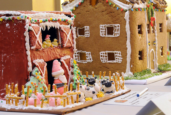 Gingerbread housed built by Mountain View High School students Audrey Johnson and Lindsey Bales, left, and another one built by Stacy Dehart, Mollie Brazille, Josh Hardman and Jane Bashford are displayed Saturday as part of the Gingerbread House Challenge.