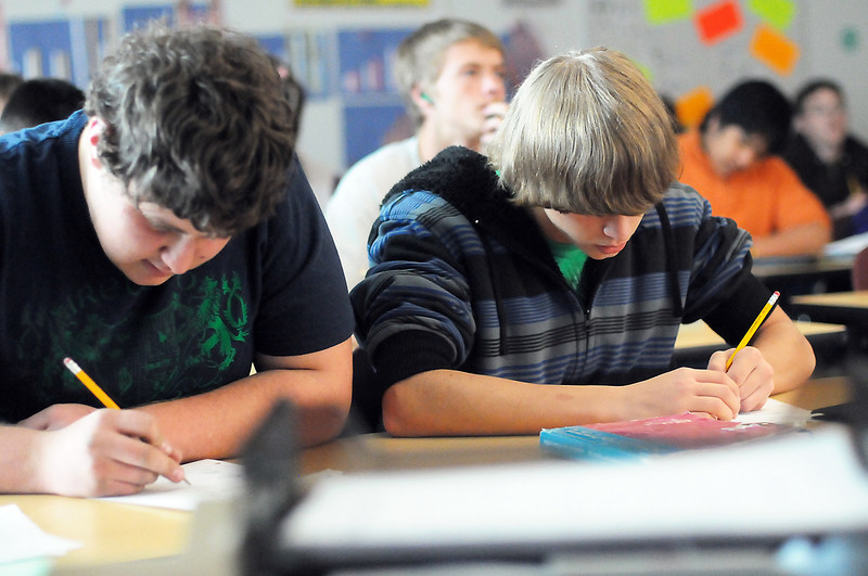 Mountain View High School junior Joel Spreitzer, 17, left, and classmate Chris Miller, 16, work on math problems during trigonometry class Thursday afternoon at the school.