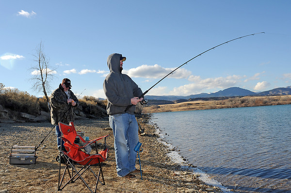 Phil Hancock, right, and his dad, Cliff, fish together Thursday afternoon along the south shore of Lon Hagler Reservoir.