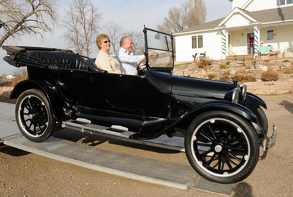"Keith and Marilyn Smith drive down a ramp in their 1919 Dodge Brothers touring car that was delivered Friday, Dec. 24, 2010 to their Johnstown home. The car was used in the filiming of the classic Christmas movie from 1946 called, ""It's a Wonderful Life."""