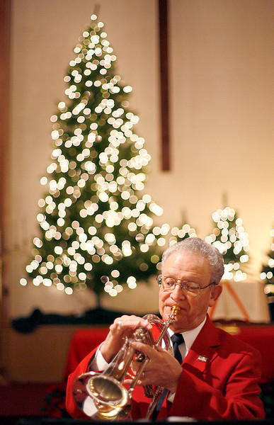 Gil Garcia plays Christmas songs on his trumpet with his band, Touch of Jazz, Sunday morning before service at the First Baptist Church.<br />  Photo by Gabriel Christus