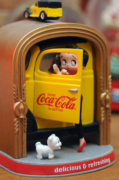 One of the items in Victoria Villavicencio's collection of Coca-Cola memorabilia is this music maker featuring the cartoon character Betty Boop.