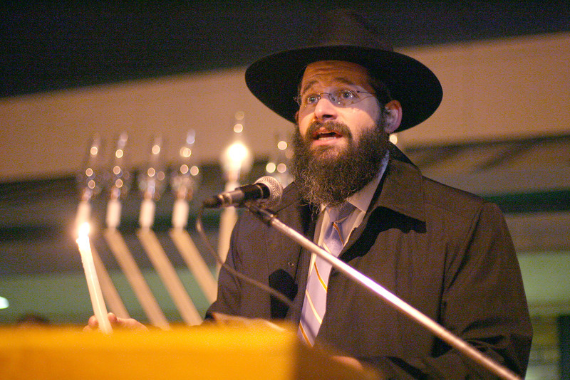 Rabbi Yerachmiel Gorelik sings prayers during Loveland's Menorah lighting on Monday  at Peter Park. Photo by Gabriel Christus