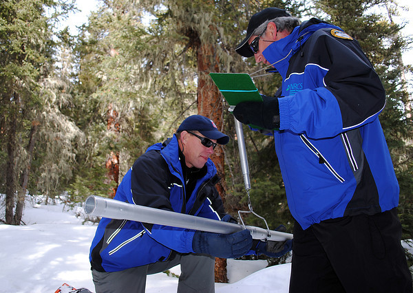 Todd Boldt, left, and John Fusaro measure the amount of water in the snow accumulated so far at Hidden Valley in Rocky Mountain National Park on Monday. The National Resource Conservation Service snow specialists snowshoe into sites once a month, January through April, to measure snowpack for the season.