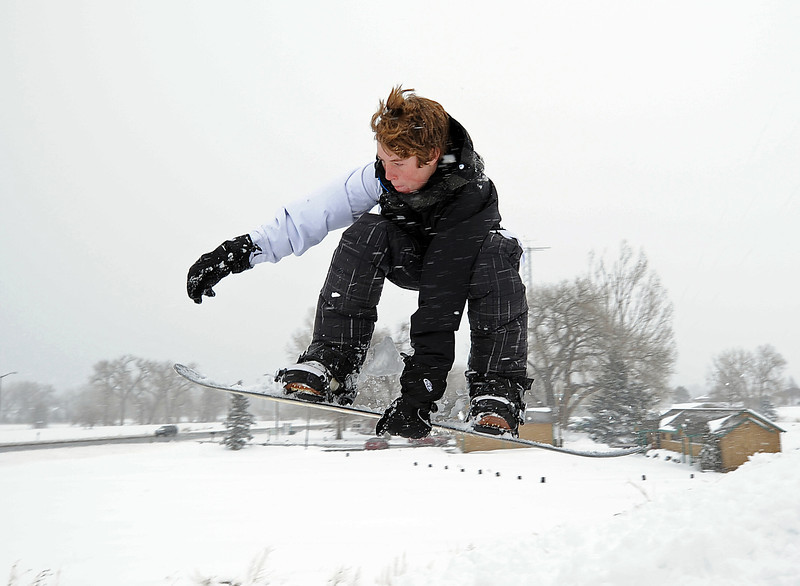Shane McFadden, 14, flies over a jump while snowboarding Friday in Loveland.