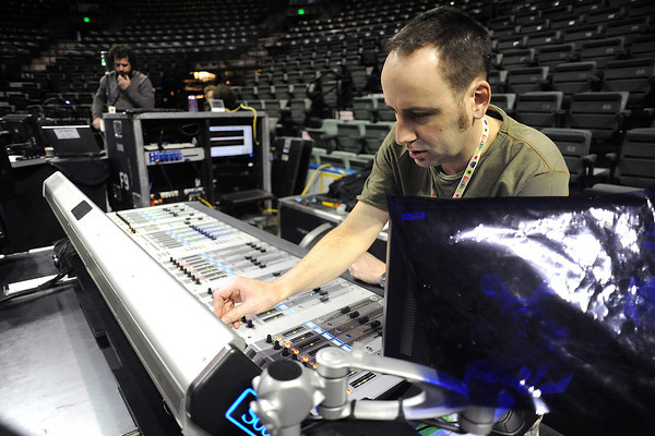 Head of sound Glen Beckley, right, works on a mixing console Tuesday at the Budweiser Events Center in preparation for the show Dralion which continues through Sunday at the BEC.