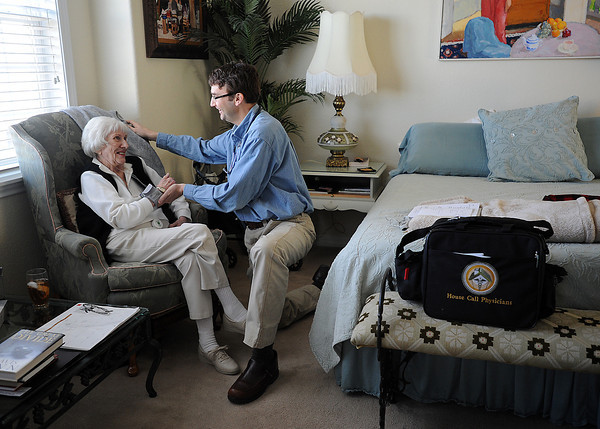 Dr. Mitch Janasek takes a blood pressure and pulse reading on patient Pat Bowen at her home Wednesday in Fort Collins. House Call Physicians was started by Dr. Brian Mathwich two years ago to serve Northern Colorado homebound patients. (Photo by Jenny Sparks)