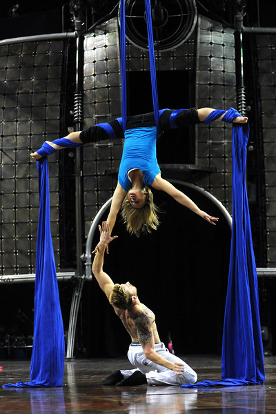 Cirque du Soleil aerialists Amanda Orozco, top, and Lorant Markocscany practice their act Tuesday at the Budweiser Events Center for the show Dralion which continues through Sunday.