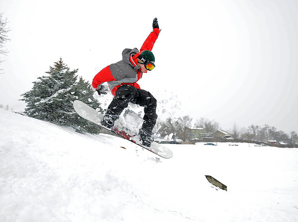Dakota Smith, 14, catches some air while snowboarding Friday at the sledding hill near South Tyler Avenue and First Street in Loveland.
