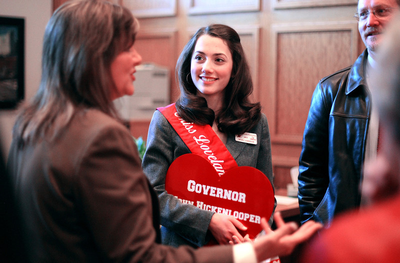 Mary Askham, 2012 Miss Loveland Valentine, holds a gift for Governor John Hickenlooper while talking to Colorado House Representative B.J. Nikkels before entering his office Monday at the State Capitol in Denver. Askham was chosen to be 2012 Miss Loveland Valentine and got to tour the Capitol and meet with Governor Hickenlooper and House Representatives Nikkels and Del Grosso. Photo by Gabriel Christus