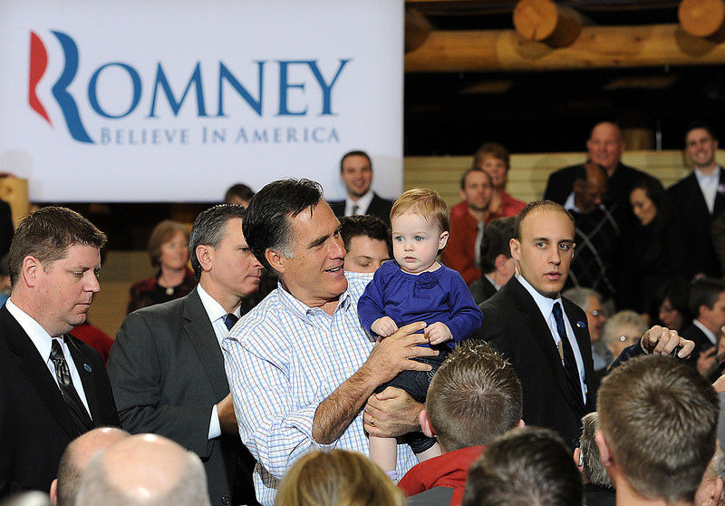 "Mitt Romney holds 11 month-old Madison Busch of Loveland Tuesday during a presidential candidate rally at RV America in Johnstown. When talking about Romney holding her daughter Julie Busch said ""My heart just totally fell. All we wanted was a picture. I didn't think he would actually pick her up."" Photo by Jenny Sparks"