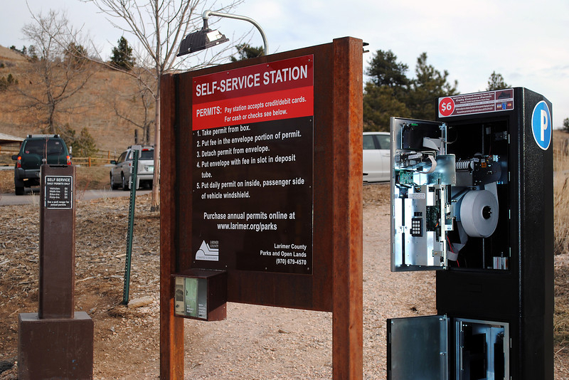 "A new automated pay station at Horsetooth Mountain Park allows visitors to pay their entrance fees with a debit or credit card. The ""iron ranger"" will sit next to the old fashioned cash or check pay envelopes for six months while county officials study if it follows research that suggests automated systems are more efficient and preferred by visitors."