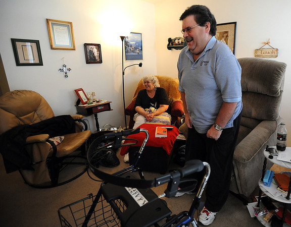 George Knight shows how he can stand without holding on to his walker Thursday as his wife Marlyn Knight smiles. Knight had a severe reaction to a contrast dye injected into his system during a medical test and was confined to a wheelchair for years. He kept a positive attitude the whole time. Photo by Jenny Sparks
