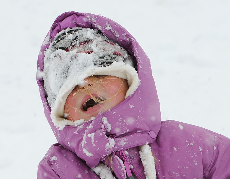 "Jolynn Paulsen, 8, yells out ""I can't see anything"" after sledding down a hill in Loveland on Friday."