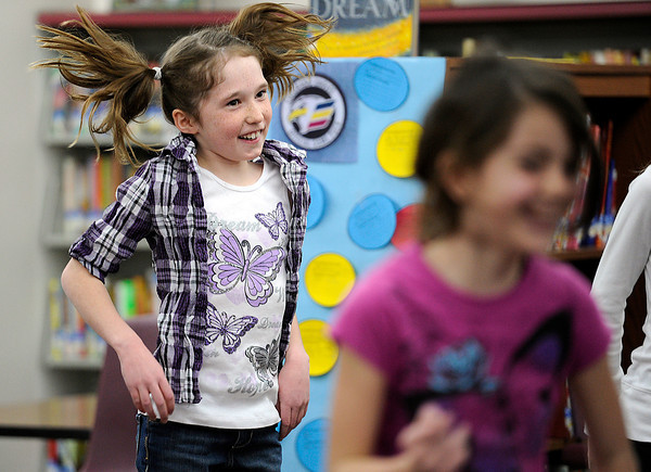 B.F. Kitchen Elementary School student Arden McCauley, 10, jumps while exercising with classmates Friday during school in the library. Students at the school are logging minutes they exercise each day as part of the Schools on the Move Challenge. Photo by Jenny Sparks