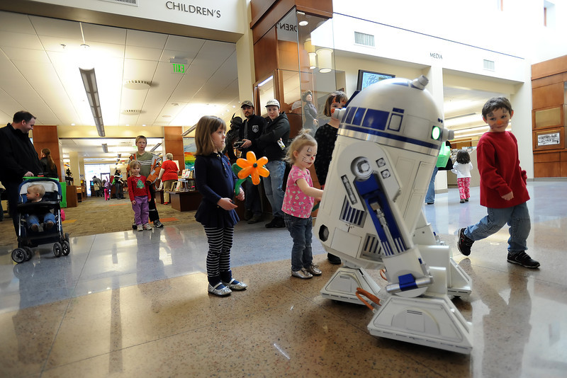 Youngsters check out a replica of the Star Wars character R2-D2 during the grand reopening of the Loveland Public Library on Saturday, Feb. 18, 2012.