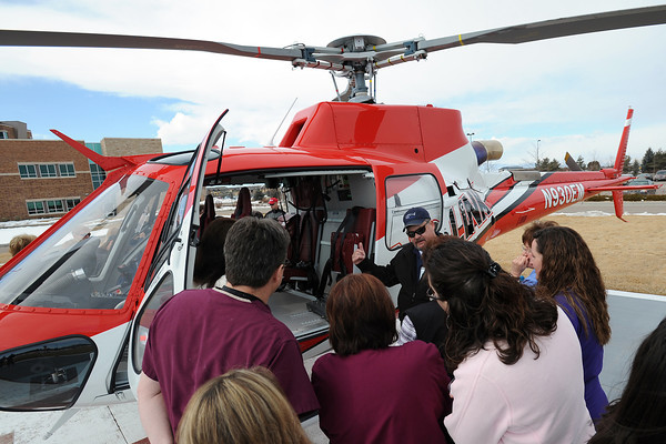 Aircraft mechanic Tim Shannon, back right, answers questions about Medical Center of the Rockies' Air Link helicopter on Tuesday, Feb. 14, 2012 shortly after the helicopter touched down on the helipad outside the hospital.