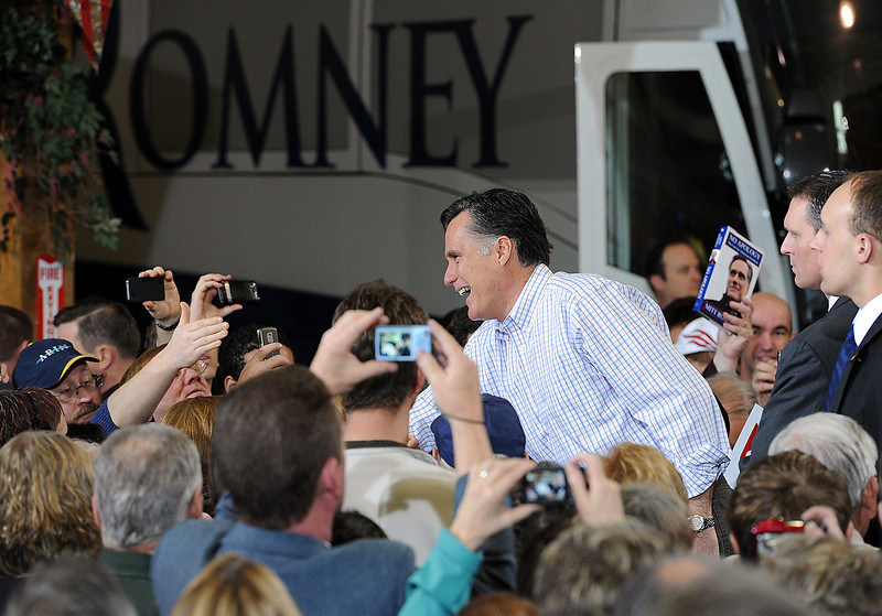 Mitt Romney shakes hands with supporters Tuedsay during a presidential campaign rally at RV America in Johnstown. Romney mentioned this is the first time they have been able to drive their bus into a building for a rally. Photo by Jenny Sparks