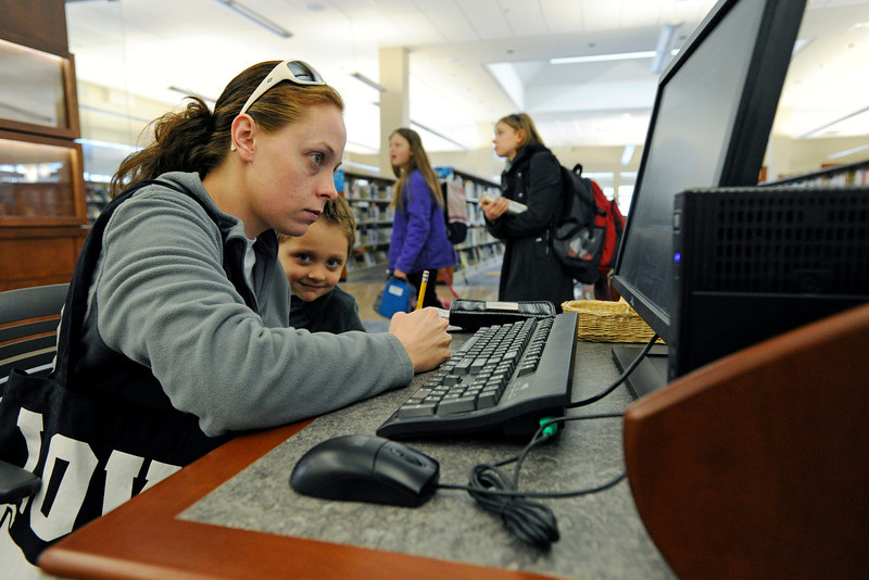Loveland resident Karli Bovee, left, and her son, Blake, 3, look up a book on a computer in the adult section of the newly-remodeled Loveland Public Library on Thursday, Feb. 9, 2012.