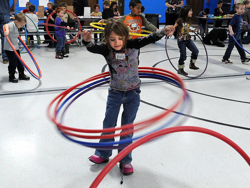 Kizzy Manhart, 6, a B.F. Kitchen Elementary School student hula hoops Friday in the gym at school. Students at the school are logging minutes they exercise each day as part of the Schools on the Move Challenge. Photo by Jenny Sparks