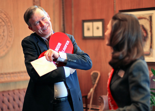 Governor John Hickenlooper hugs the the heart that Mary Askham, 2012 Miss Loveland Valentine, gave him during her tour Monday at the State Capitol in Denver. Askham was chosen to be 2012 Miss Loveland Valentine and got to tour the Capitol and meet with Governor Hickenlooper and House Representatives Nikkels and Del Grosso. Photo by Gabriel Christus