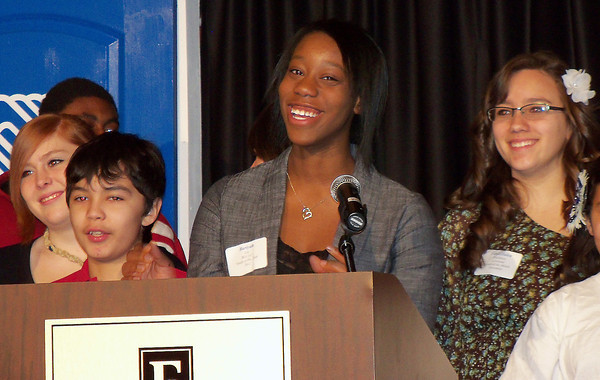 Seventeen-year-old Bariyah Lee, the Boys and Girls Clubs of Larimer County 2012 Youth of the Year, smiles with the rest of the Youth of the Month winners during the Youth of the Year Breakfast Tuesday at the Embassy Suites Loveland. Photo by Shelley Widhalm