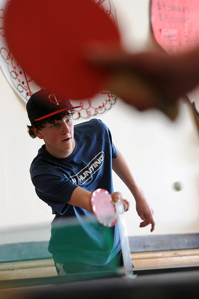 Loveland High School sophomore Alex Krabbenhoft, 16, returns a shot while playing in the first round of a pingpong tournament Wednesday afternoon at the school. The LHS Student Council put on the event as a fundraiser and had both a singles and a doubles bracket. The singles winner was junior Austin Anderson and the winning doubles team members were junior Jesse Jacobson and senior Mitchell Collins who were each awarded a silver-painted pingpong paddle.