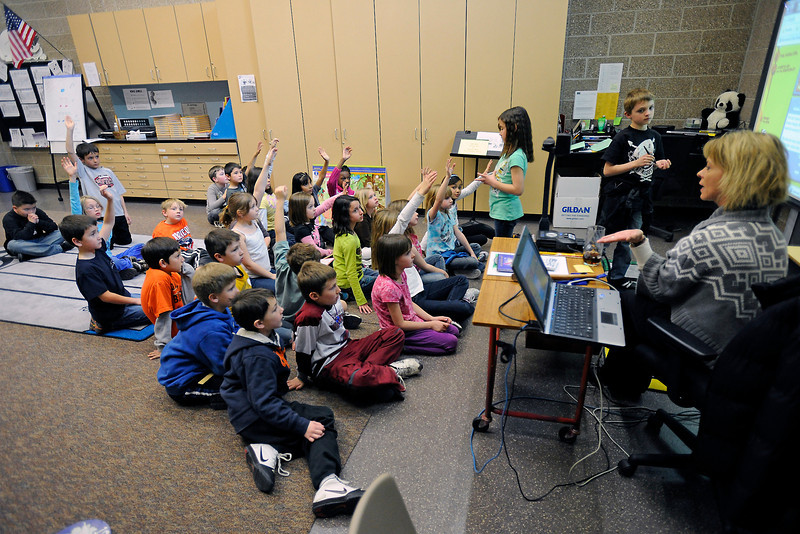 Ponderosa Elementary School second-graders work on a lesson with music teacher Susan Harding, right, during class Thursday, Feb. 9, 2012 at the school.