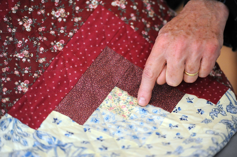 Dave Wieland shows off the first quilt he made Wednesday at his Loveland home. <br /> Photo by Jenny Sparks