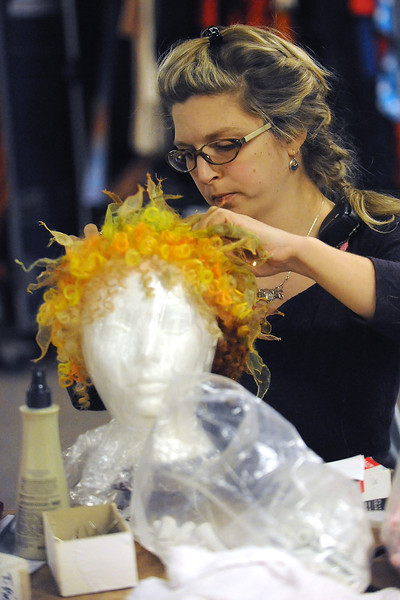 Cirque du Soleil costumer Marilou Gagne re-curls a wig Tuesday at the Budweiser Events Center in preparation for the show Dralion which continues through Sunday at the BEC.